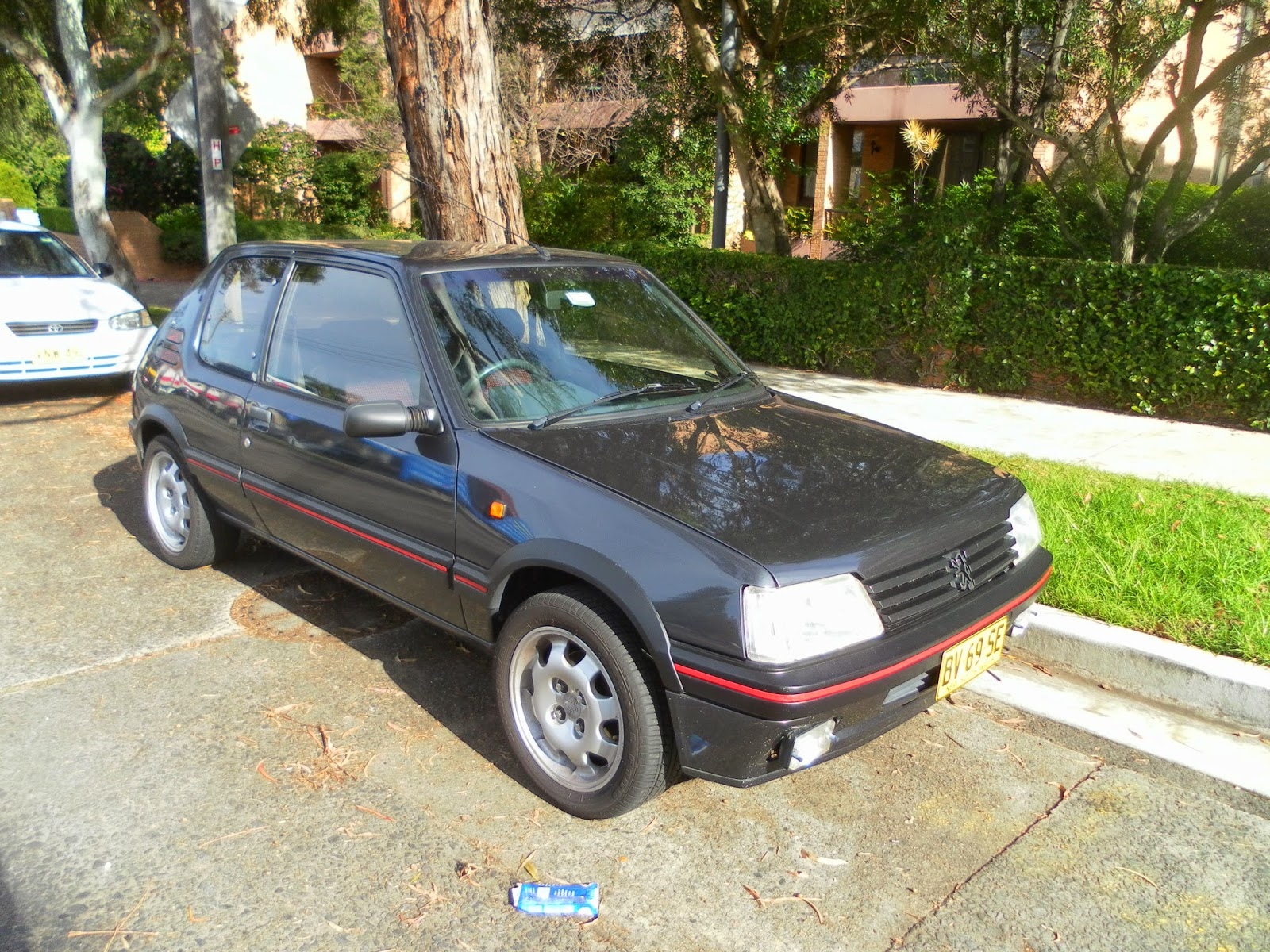 aussie old parked cars 1990 peugeot 205 gti 1 9. Black Bedroom Furniture Sets. Home Design Ideas