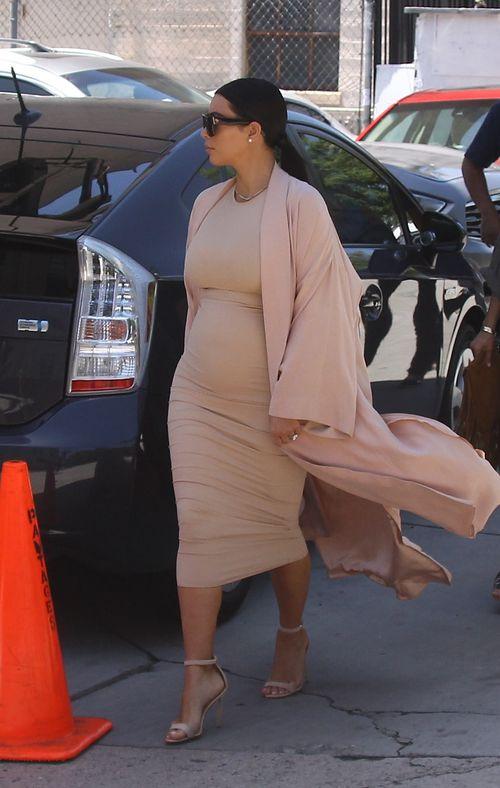 Kim Kardashian with round baby ball