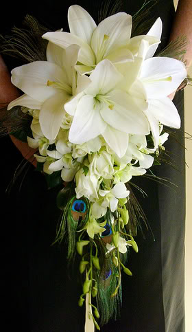 This Asiatic lily and Peacock feather bouquet is simply stunning