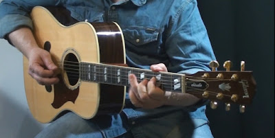Steve #5 playing his Gibson Songwriter acoustic guitar