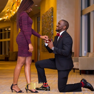 A man proposing on his knees to a young woman