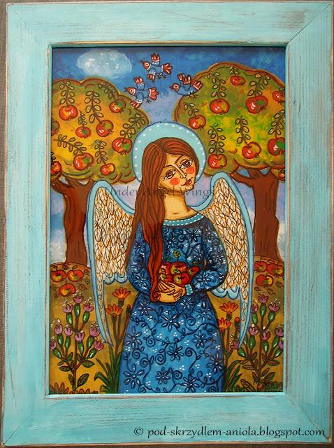 Obraz jesienny, anioł z jabłkami