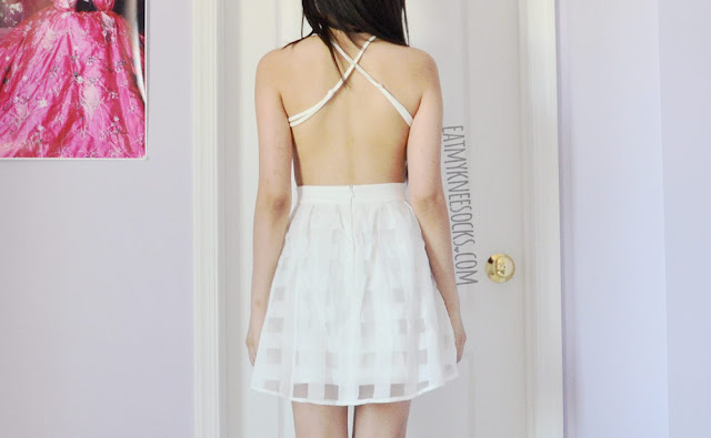 Back view of the gorgeous spaghetti strap backless design on SheIn's gridded organza skater dress.