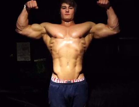 Young Male Flexing Lean Muscle