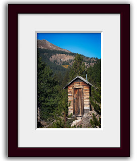 Colorado outhouse photo, of a primitive rustic privy located in the alpine ghost town of Independence, Colorado.