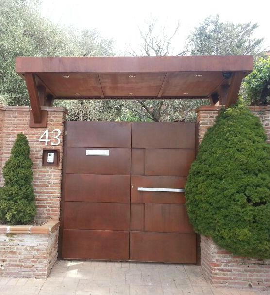 Acero corten acero corten acero inoxidable escaparates for Marquesinas para puertas de entrada