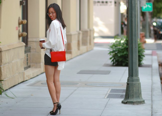 white and black outfit pop of red