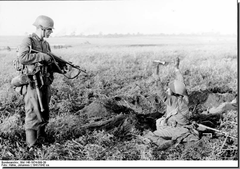 German points gun Soviet soldier raises hands