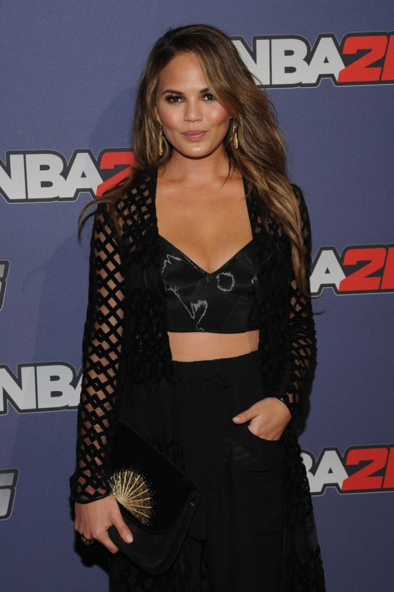Chrissy Teigen in a black bralet and skirt at the NBA 2K15 Launch Party in NYC