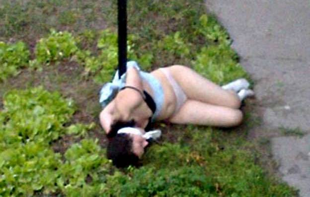 naked girl tied to post