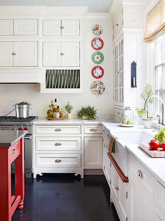 how about adding pops of color to brighten your white kitchen  in contrast to the white cabinets the colors really stand out  warming up a white kitchen  rh   thedailynest com