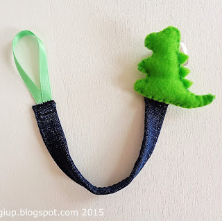 https://www.etsy.com/listing/238659173/dinosaur-pacifier-clip-with-denim-ribbon
