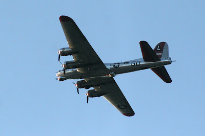 B-17 Yankee Lady over Ann Arbor Michigan from below blue sky