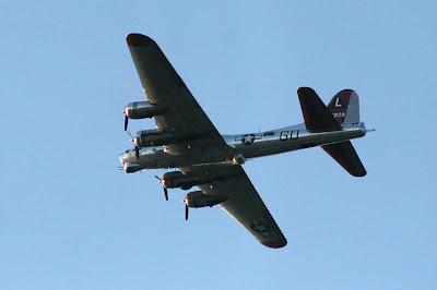 B-17 Yankee Lady over Ann Arbor Michigan from below blue sky