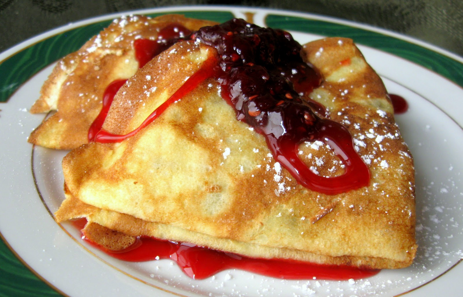 Dessert Crêpes served with Raspberry Sauce and Preserves