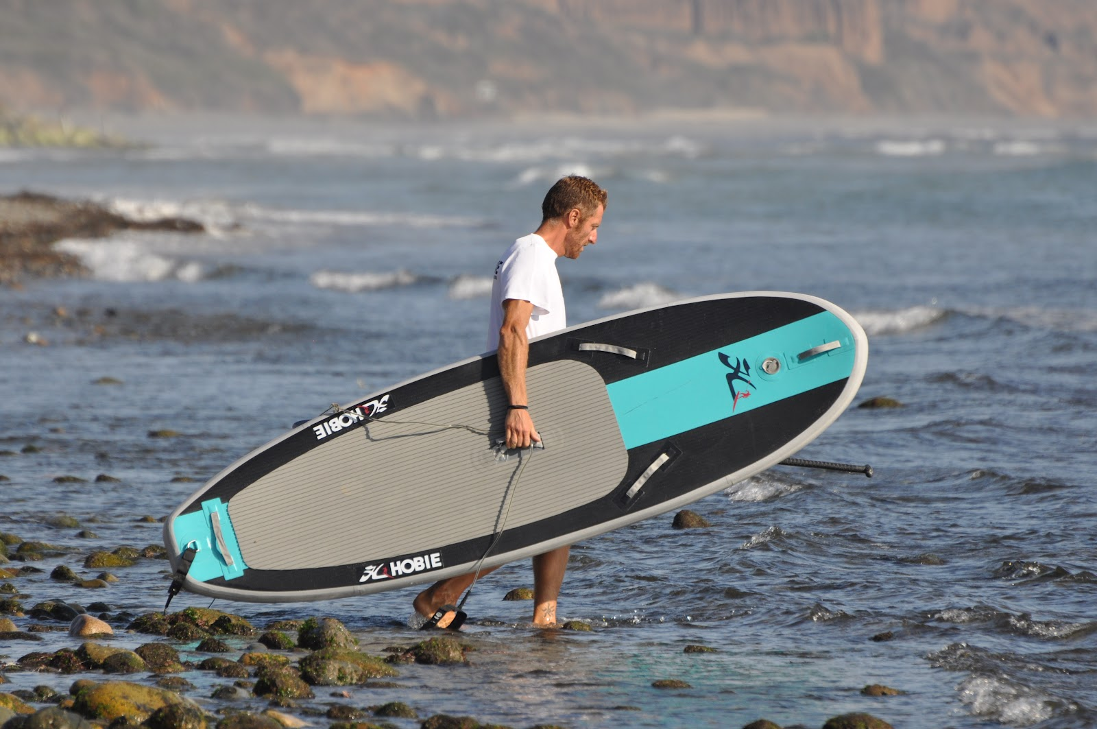 how to stand up in surf on a sup