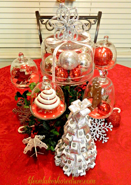 "alt=""Red and silver Christmas tablescape, cloches, mini cupcake stands"""