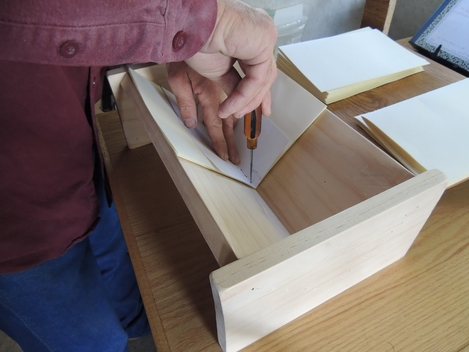 signature punching cradle for book binding