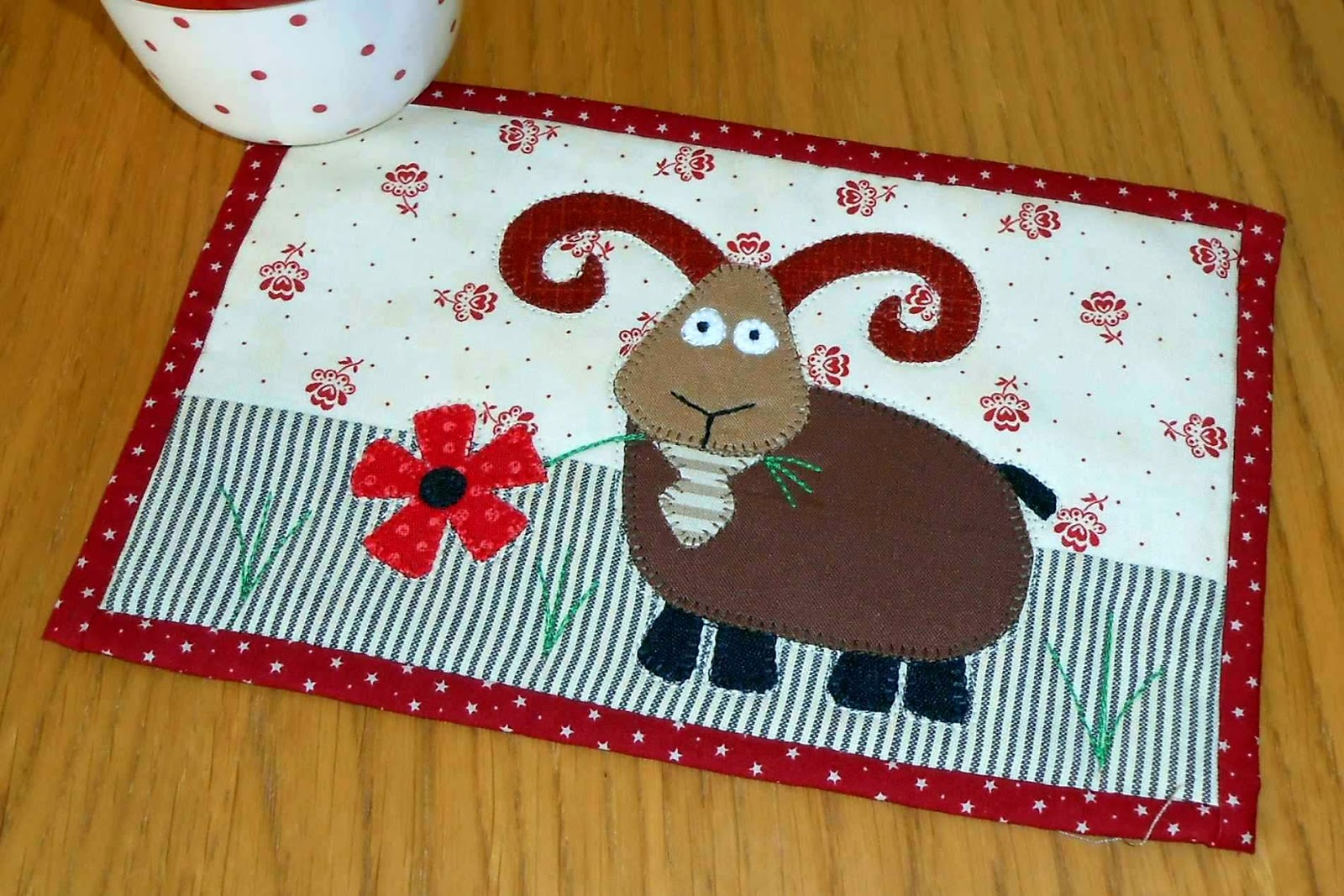http://www.craftsy.com/pattern/quilting/home-decor/billy-goat-mug-rug/89545