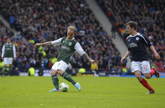 Hibernian player Leigh Griffiths shoots to score the winning goal against Falkirk