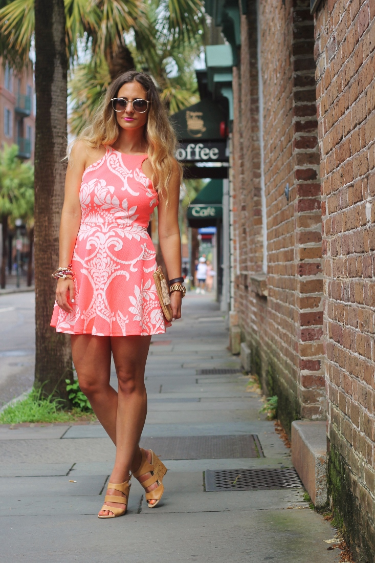 neon orange and white printed skater dress
