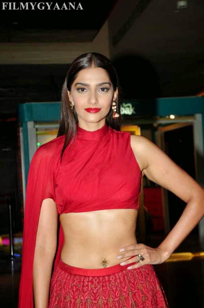 sonam kapoor hot navel show photos in red dress