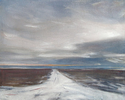 snowy road leading to the bay, dramatic sky