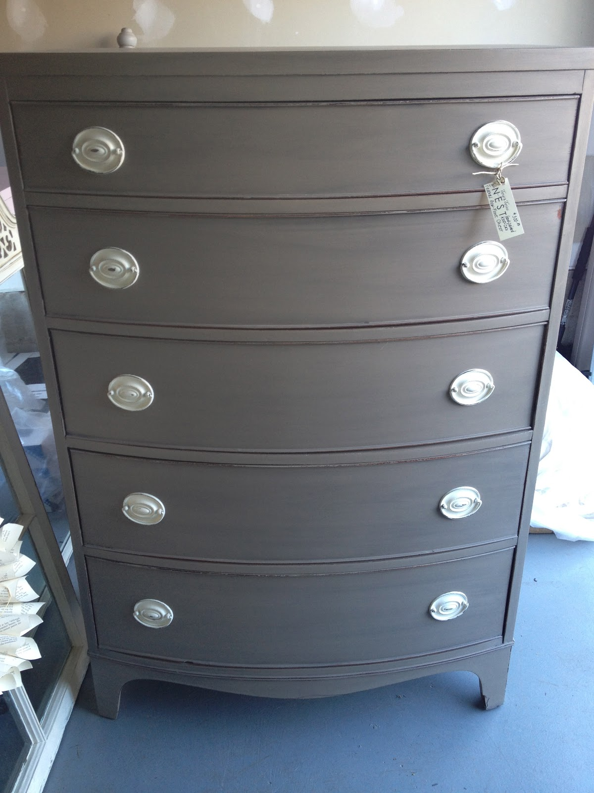 Another vintage bow front dresser painted in coco with a graphite wash