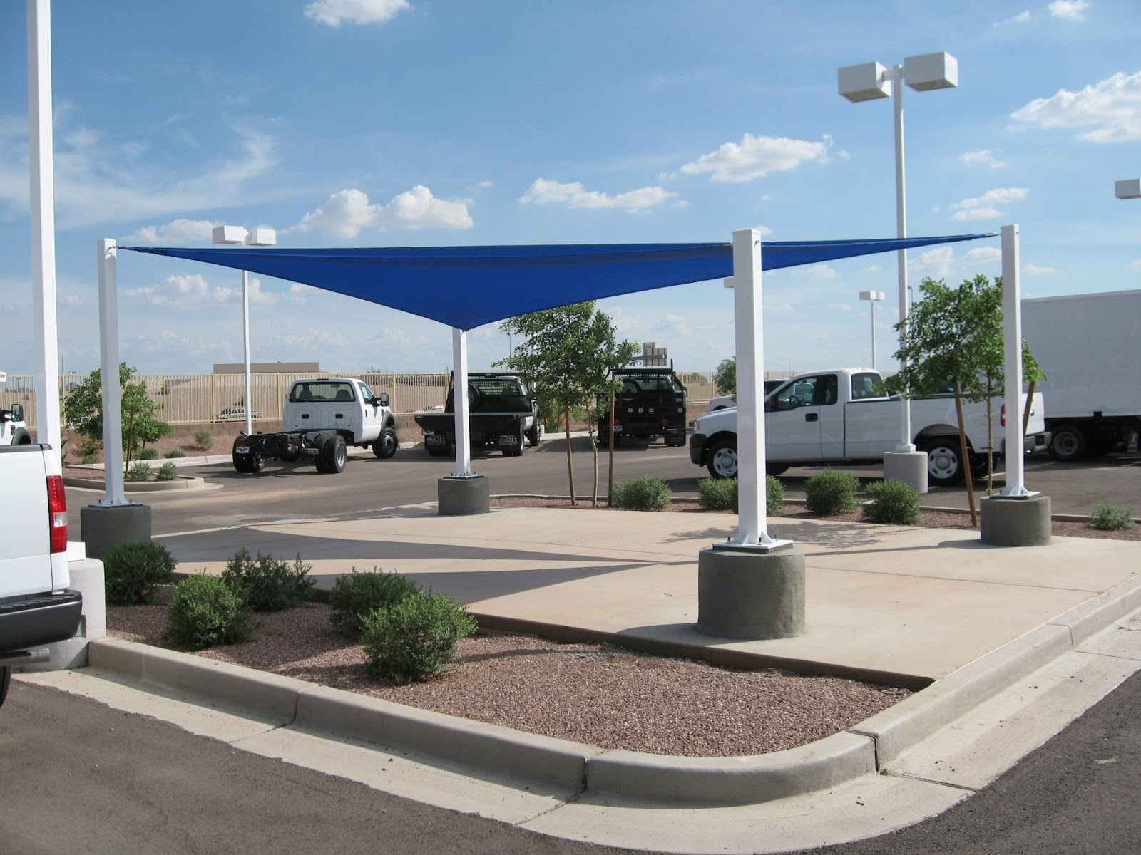 Car park sun shades swimming pool shade car parking for Sun shade structures