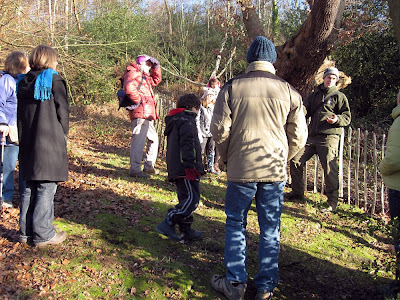 Ranger Luke Barley (right) talking to a group while standing by a veteran oak on West Wickham Common