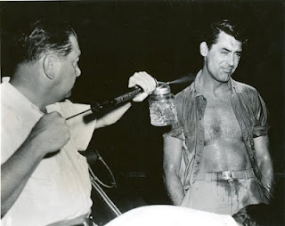 Cary Grant being sprayed