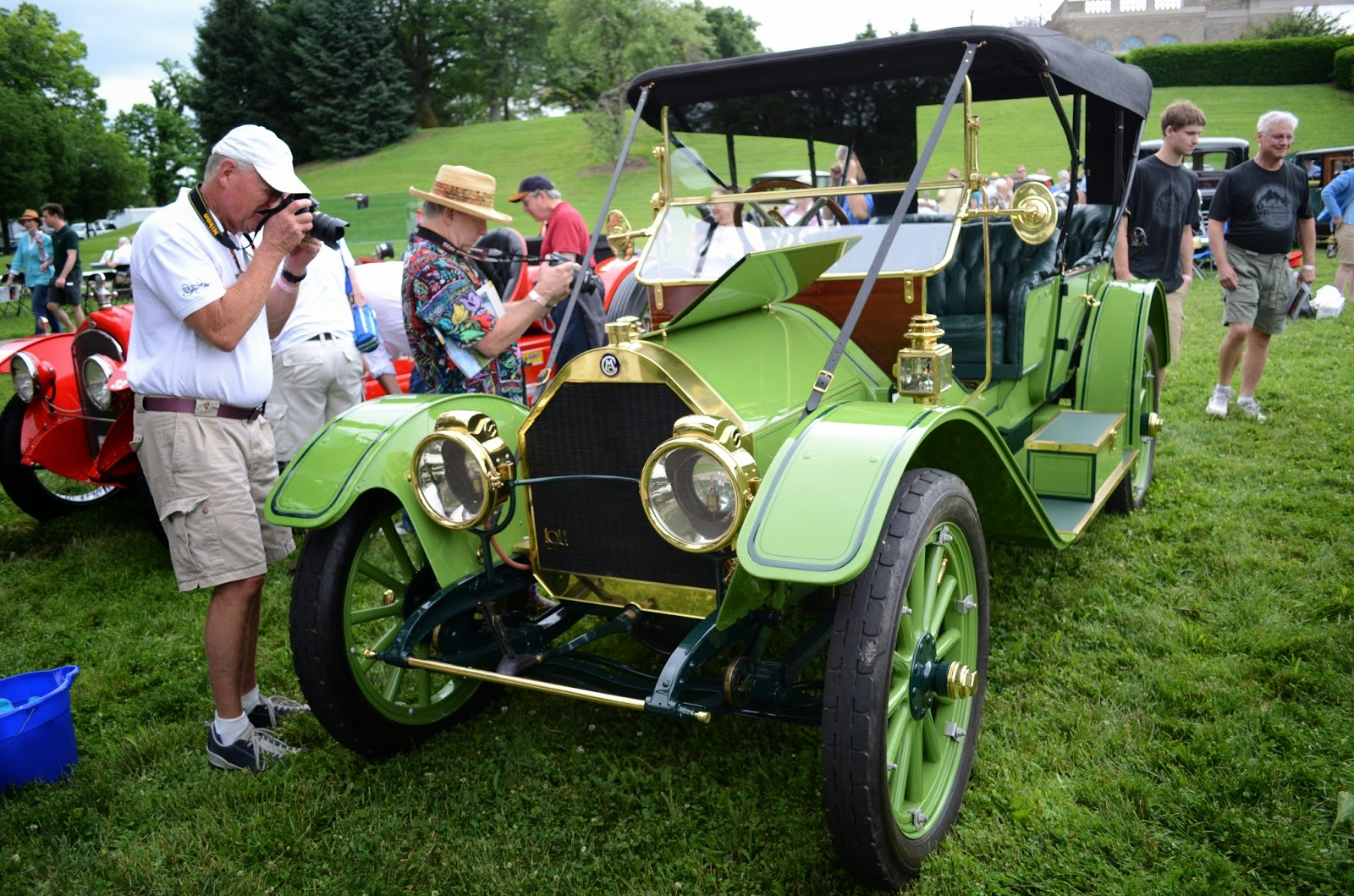 saxon two seat roadster a 1910 stevens duryea model y seven passenger touring a 1911 chalmers model 30 toy tanneau and a 1916 marmon 34a runabout