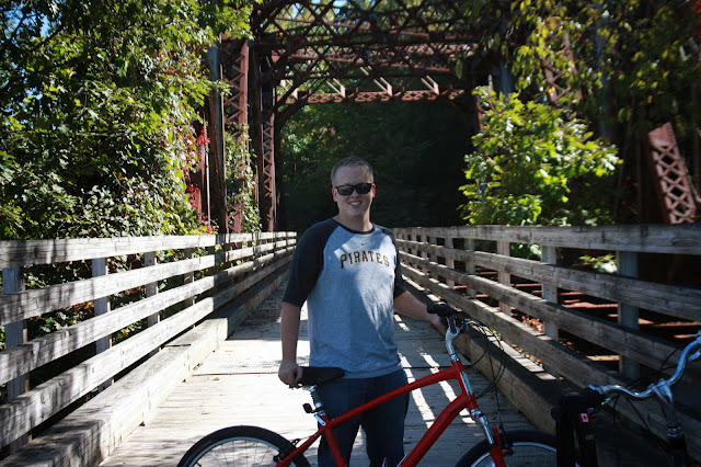 Justin posing with bike on trail