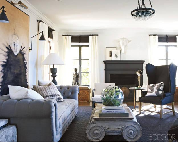 salon moderno con decoracion vintage y sofa chesterfiel