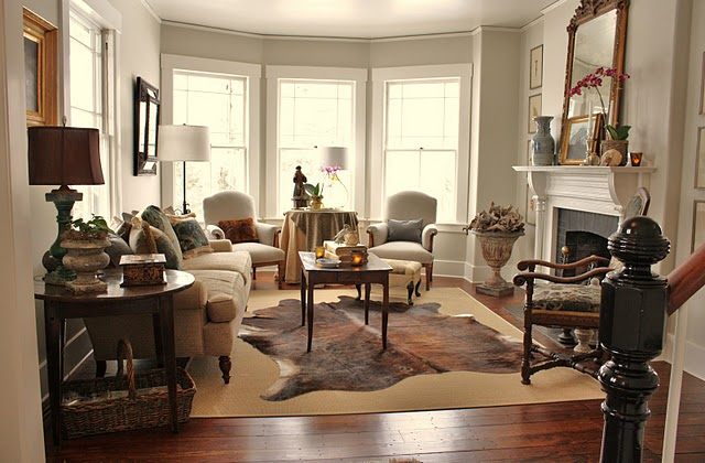 living room ideas with cowhide rug. i just think it would look perfect over my jute rug! here are some inspiration rooms that adore! living room ideas with cowhide rug