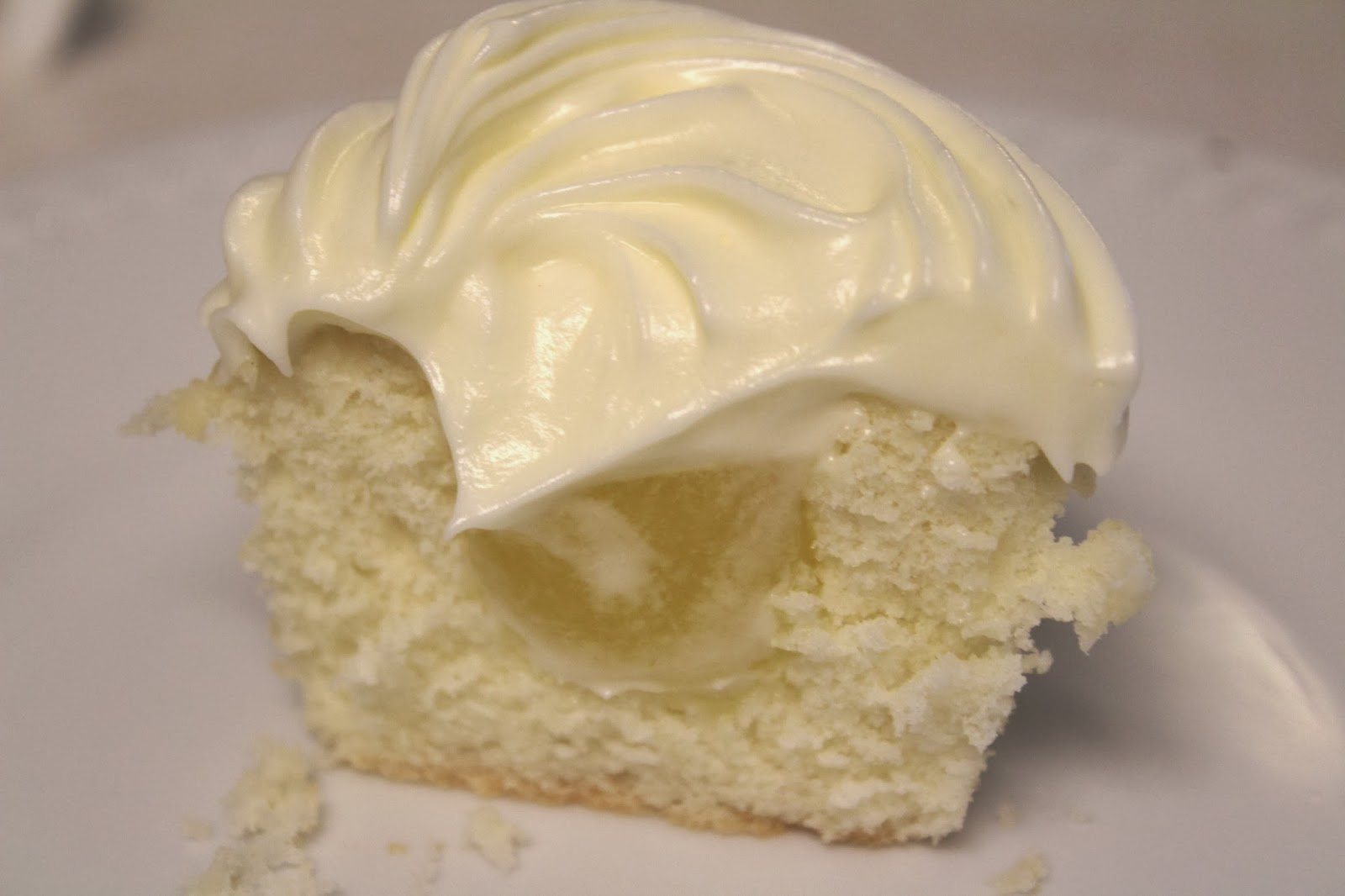 coconut cupcakes filled with lemon and topped with cream cheese ...