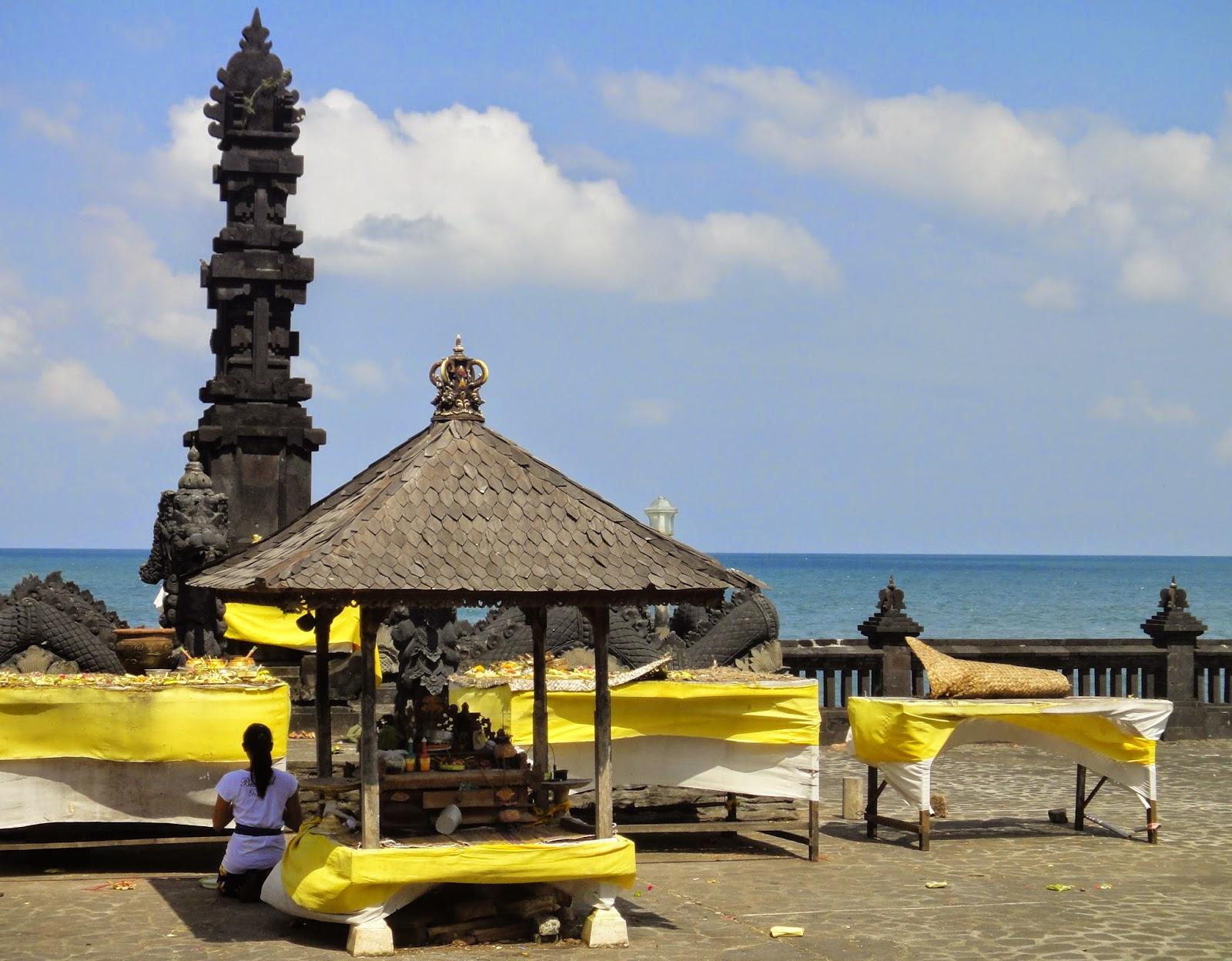 Balinese praying at Pura Tanah Lot Bali Island