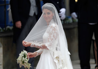 Kate carried a bouquet of myrtle, lily-of-the-valley, sweet William and hyacinth