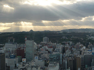 Photograph of Sendai from AER building with sun shining through clouds