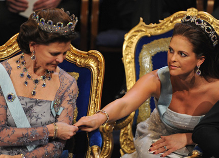 This is a photo of Princess Madeleine showing her manicure to Queen Silvia