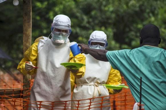 medical staffs working with full gear to avoid infecting with ebola virus