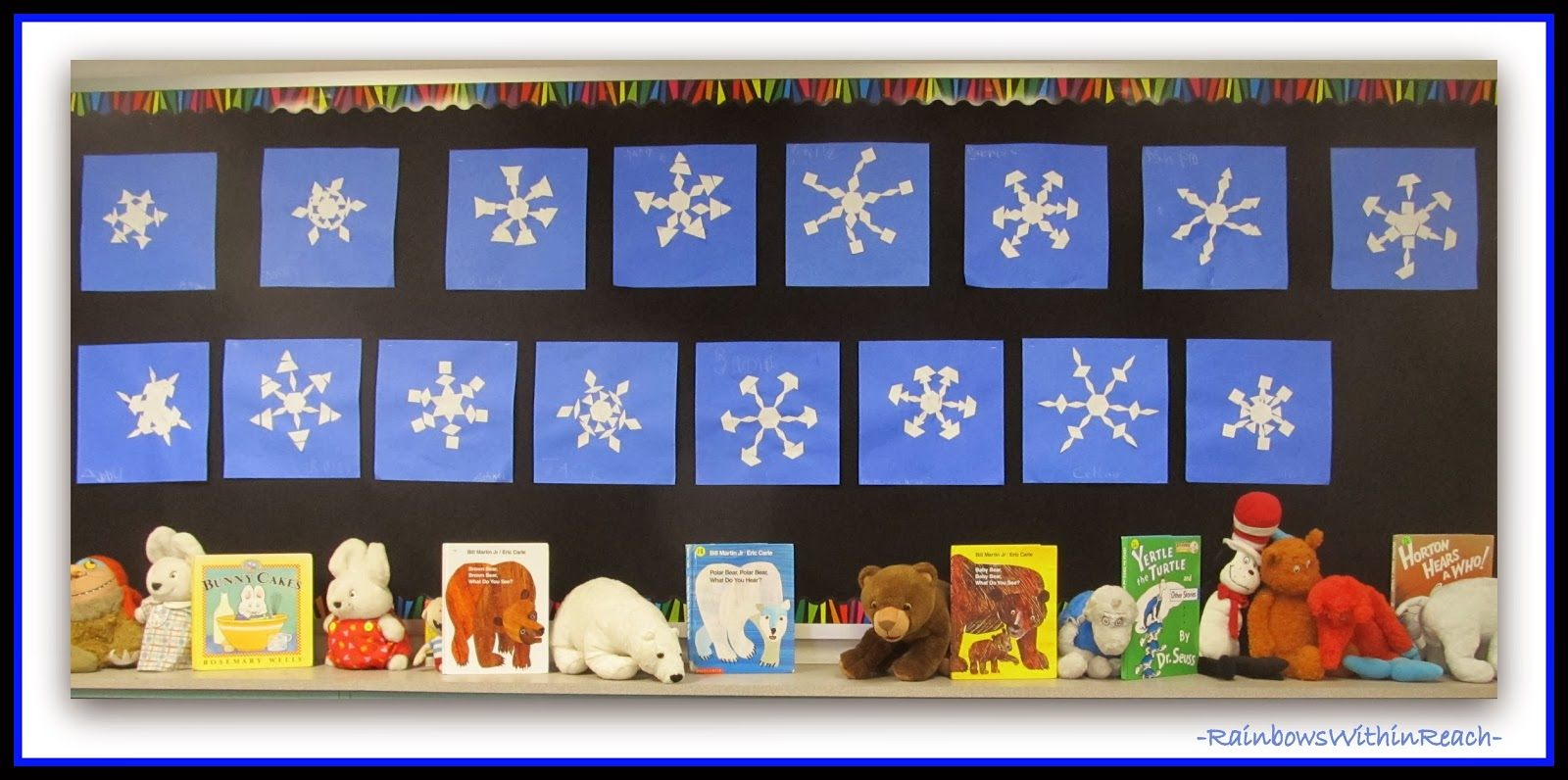 Winter Bulletin Board of Symmetric Snowflakes in Kindergarten via RainbowsWithinReach