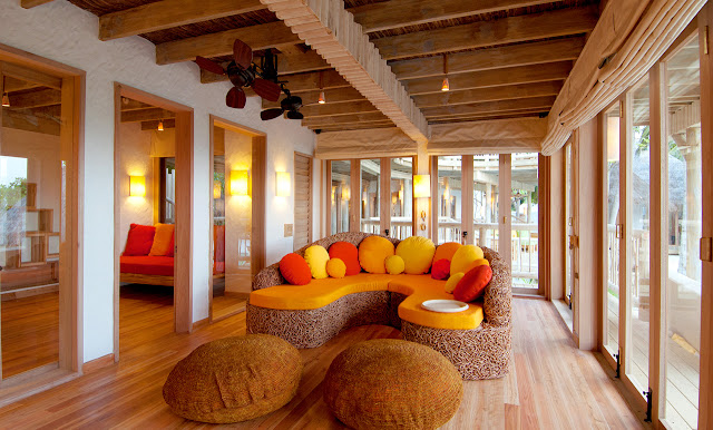 Photo of wooden sofa inside of one of the resort residences