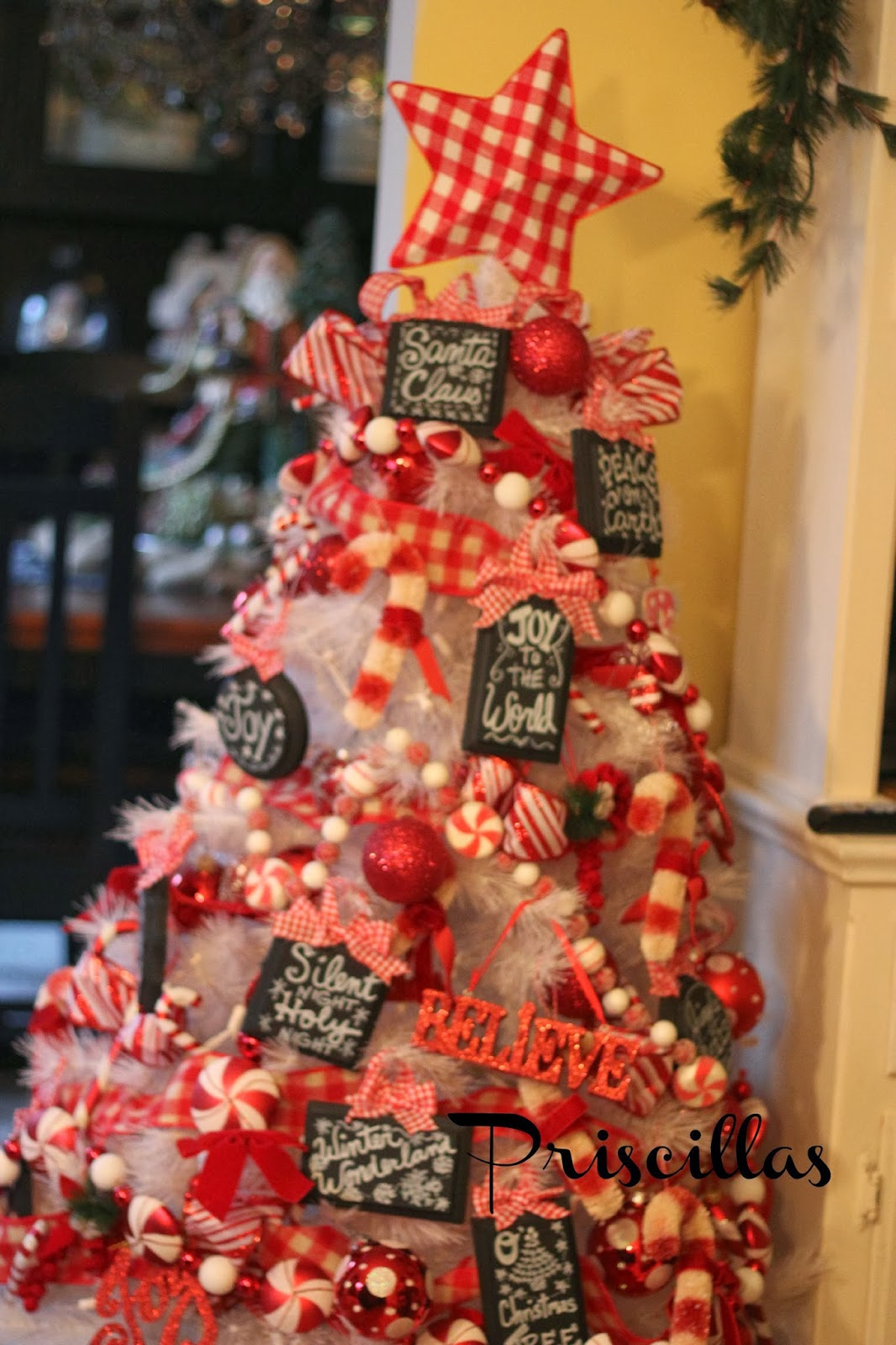 i love the candy garlands its just such a cute cheery tree for the kitchen