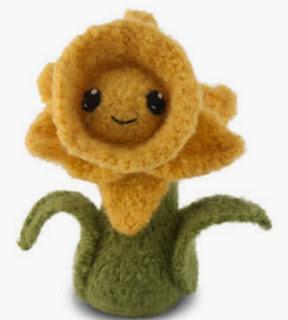 http://translate.google.es/translate?hl=es&sl=auto&tl=es&u=http%3A%2F%2Fblog.craftyalien.com%2F2012%2F04%2Ffelted-knit-daffodil-amigurumi.html%23more