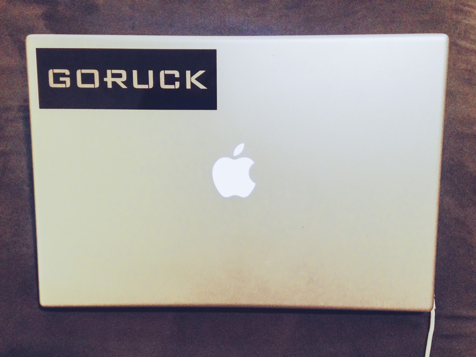 Photo of mac book pro with sticker