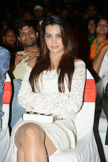 Diksha Panth in Cream Colored Short Dress at Bham Bolenath Audio Release Function
