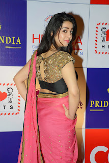 Actress Charmy Kaur Latest Pictures in Pink Saree at CCL Charity Dinner  22