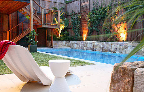 Pool design with easy maintenance in the backyard for Simple pool landscaping ideas