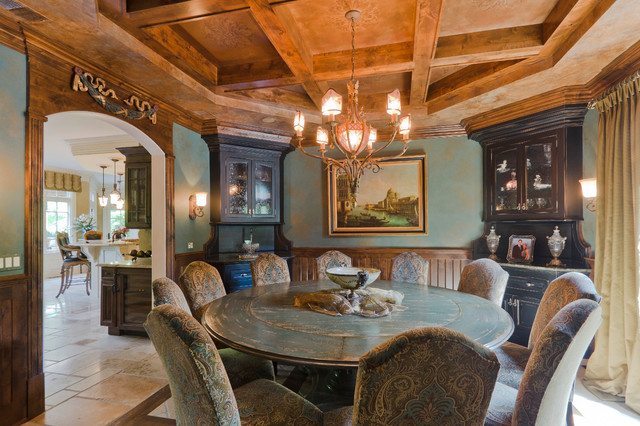 Bright Light from Classic Chandelier above the Rounded Dining Room Tables And Chairs in Traditional Dining Space